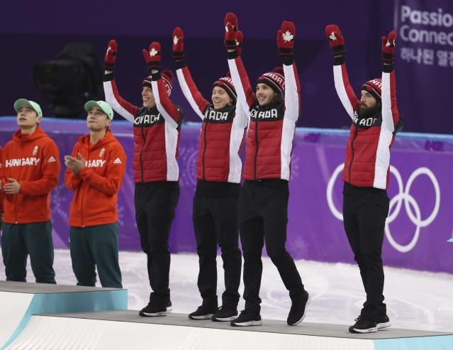 Short Track Speed Skating Events - Pyeongchang 2018 Winter Olympics - Men's 5000m Relay Final - Gangneung Ice Arena - Gangneung, South Korea - February 22, 2018 - Bronze medallists Samuel Girard, Charles Hamelin, Charle Cournoyer and Pascal Dion of Canada acknowledge the crowds on the podium. REUTERS/Lucy Nicholson