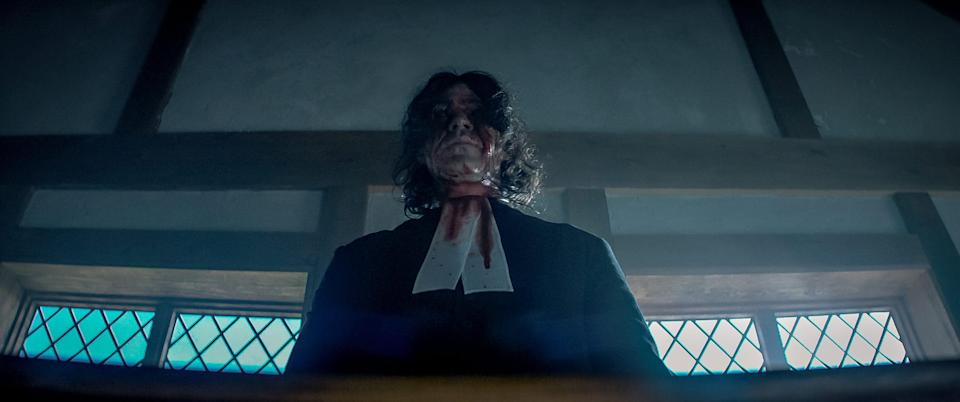 """Cyrus Miller (Michael Chandler), aka The Pastor, is an all-seeing 17th-century church figure central to one of the most disturbing scenes in """"Fear Street Part 3: 1666."""""""