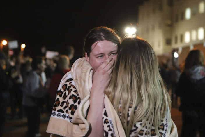 Relatives hug after being released from a detention center where protesters were detained during a mass rally following presidential election in Minsk, Belarus, Friday, Aug. 14, 2020. Nearly 7,000 people have been detained and hundreds injured in the clampdown on demonstrators protesting the official results that said Lukashenko won 80% of the vote and his top opposition challenger got only 10%. Police have broken up protests with stun grenades, tear gas, rubber bullets and severe beatings. (AP Photo)