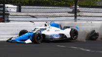 The car driven by Alex Palou of Spain hits the wall in the second turn during qualifications for the Indianapolis 500 auto race at Indianapolis Motor Speedway in Indianapolis, Saturday, May 22, 2021. (AP Photo/Jamie Gallagher)
