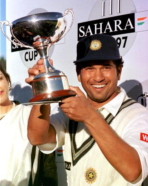 TORONTO, CANADA:  India's captain Sachin Tendulkar hoists the Sahara Cup after his team beat Pakistan four games to one at the Sahara Cup cricket exhibition match in Toronto, Canada, 21 September.   AFP PHOTO/Carlo ALLEGRI (Photo credit should read CARLO ALLEGRI/AFP/Getty Images)