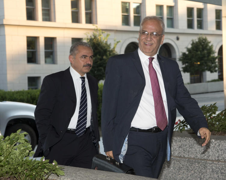 Saeb Erekat, right, Palestinian chief negotiator and Mohammad I. Shtayyeh, left, Minister Palestinian Economic Council for Development and Reconstruction, arrive at the State Department in Washington, Monday, July 29, 2013. (AP Photo/Pablo Martinez Monsivais)