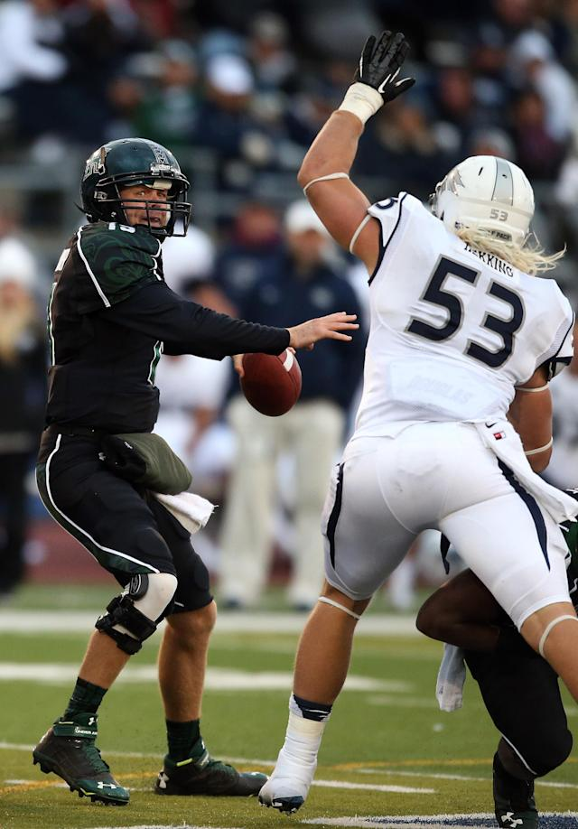 Hawaii's Sean Schroeder, left, looks down field against the Nevada defense during the first half of an NCAA college football game in Reno, Nev., on Saturday, Sept. 21, 2013. (AP Photo/Cathleen Allison)
