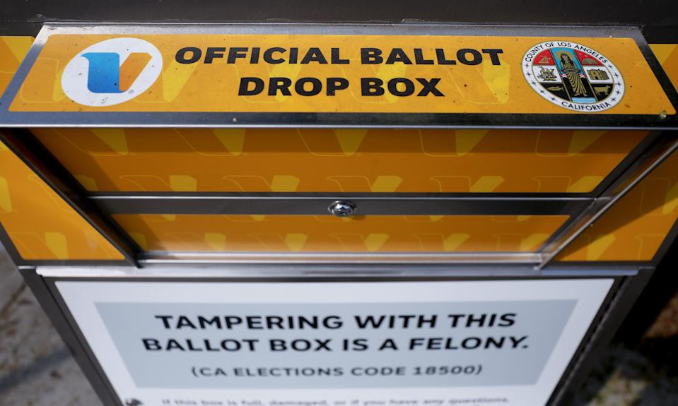 An official mail-in ballot drop box is posted outside of a library ahead of Election Day on October 5, 2020, in Los Angeles, Calif. One of these boxes was set on fire in an incident officials are investigating as arson.