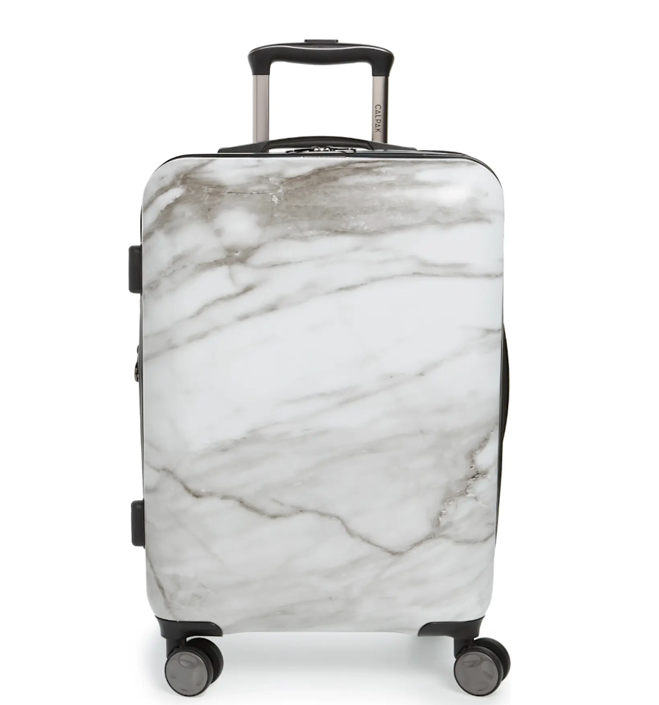 """<h2>Best Rolling Luggage For Long Trips<br></h2><br><h3>CALPAK Astyll 22-Inch Rolling Spinner Suitcase</h3><br>CALPAK's aesthetically pleasing white marble spinner suitcase is top-rated and durbale.<br><br><strong>The Hype</strong>: 4.4 out of 5 stars and 68 reviews<br><br><strong>Out Of Towners say</strong>: """"I love this suitcase —it's cute, lightweight, and sturdy. I've never had an issue with it as a carry-on on various domestic and international flights and it fits enough for two to three-week trips. The wheels are smooth and it has held up beautifully despite being banged around and dragged through the cobbled streets of Europe.""""<br><br><em>Shop <strong><a href=""""https://www.nordstrom.com/brands/calpak--14515?origin=productBrandLink"""" rel=""""nofollow noopener"""" target=""""_blank"""" data-ylk=""""slk:CALPAK"""" class=""""link rapid-noclick-resp"""">CALPAK</a></strong><br></em><br><br><strong>Calpak</strong> Astyll 22-Inch Rolling Spinner Suitcase, $, available at <a href=""""https://go.skimresources.com/?id=30283X879131&url=https%3A%2F%2Fwww.nordstrom.com%2Fs%2Fcalpak-astyll-22-inch-rolling-spinner-suitcase%2F4521593"""" rel=""""nofollow noopener"""" target=""""_blank"""" data-ylk=""""slk:Calpak"""" class=""""link rapid-noclick-resp"""">Calpak</a>"""