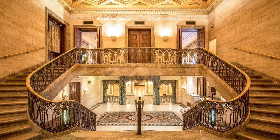 """<p>Built in 1913 to rival the grandeur of the finest European hotels, Wilmington's <a href=""""https://go.redirectingat.com?id=74968X1596630&url=https%3A%2F%2Fwww.tripadvisor.com%2FHotel_Review-g34059-d114447-Reviews-HOTEL_DU_PONT-Wilmington_Delaware.html&sref=https%3A%2F%2Fwww.redbookmag.com%2Fabout%2Fg34149750%2Fmost-historic-hotels%2F"""" rel=""""nofollow noopener"""" target=""""_blank"""" data-ylk=""""slk:Hotel du Pont"""" class=""""link rapid-noclick-resp"""">Hotel du Pont</a> is rich with gilded hallways, intricately carved woodworks, crystal chandeliers, and mosaic tiled floors. It also has the opulent <a href=""""https://www.tripadvisor.com/Restaurant_Review-g34059-d517839-Reviews-Green_Room-Wilmington_Delaware.html"""" rel=""""nofollow noopener"""" target=""""_blank"""" data-ylk=""""slk:Green Room"""" class=""""link rapid-noclick-resp"""">Green Room</a>, a special occasion restaurant, featuring a 3,000-bottle wine cellar. </p>"""