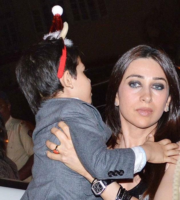 Karisma walks out with her son Kiaan