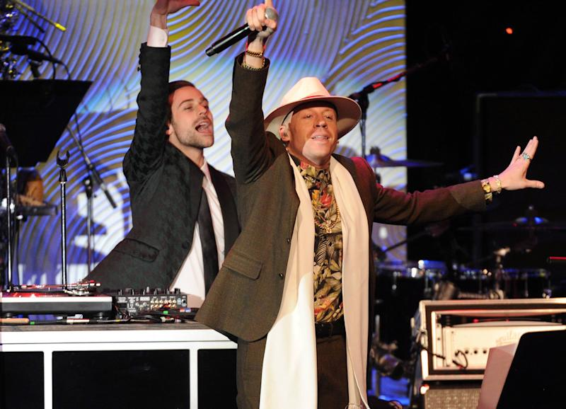 Recording artist Macklemore performs onstage at The 56th Annual GRAMMY Awards Salute to Industry Icons with Clive Davis, on Saturday, Jan. 25, 2014 at the Beverly Hilton Hotel in Beverly Hills, Calif. (Photo by Frank Micelotta/Invision/AP)