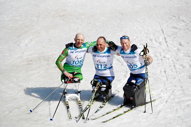 Cross-Country Skiing - Pyeongchang 2018 Winter Paralympics - Men's 1.1km Sprint - Sitting - Final - Alpensia Biathlon Centre - Pyeongchang, South Korea - March 14, 2018 - Gold medallist Andrew Soule (112) of the U.S., silver medallist Dzmitry Loban (106) of Belarus and bronze medallist Daniel Cnossen (105) of the U.S. REUTERS/Carl Recine