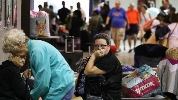 PHOTO: Evacuees sit inside of the Germain Arena that is serving as a shelter from the approaching Hurricane Irma, Sept. 9, 2017 in Estero, Florida.  (Mark Wilson/Getty Images)