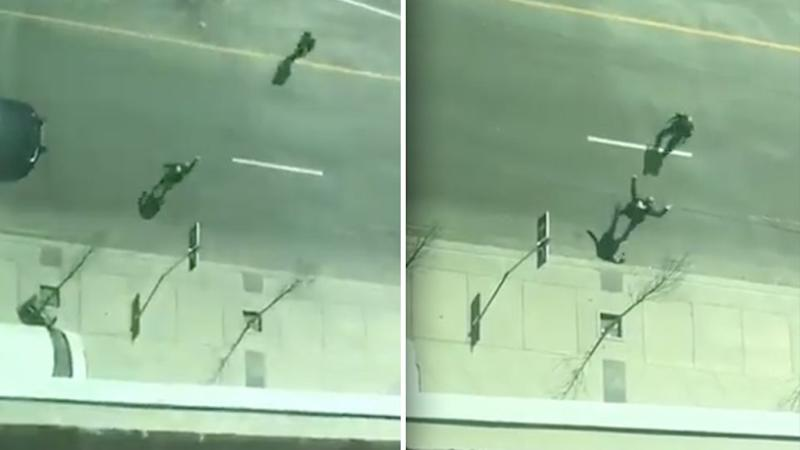 The suspect can be seen pointing an object at the police officer before dropping to his knees. Source: Twitter/Waqas Mahmud