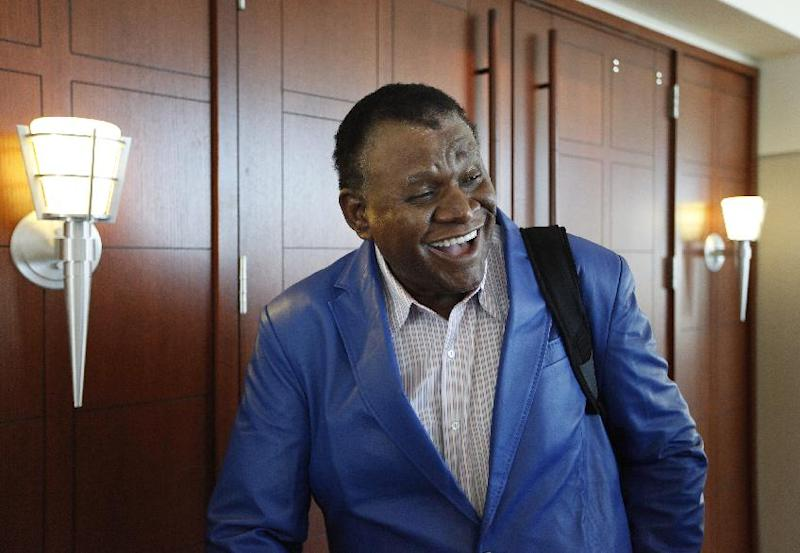 Comedian George Wallace leaves a courtroom in Las Vegas on Tuesday, April 8, 2014 after a jury awarded him $1.3 million in his case against the Bellagio hotel-casino for a 2007 incident where he was injured on stage. (AP Photo/Las Vegas Review-Journal, John Locher)