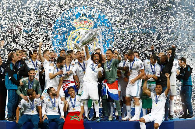 Soccer Football - Champions League Final - Real Madrid v Liverpool - NSC Olympic Stadium, Kiev, Ukraine - May 26, 2018 Real Madrid celebrate winning the Champions League with the trophy REUTERS/Kai Pfaffenbach