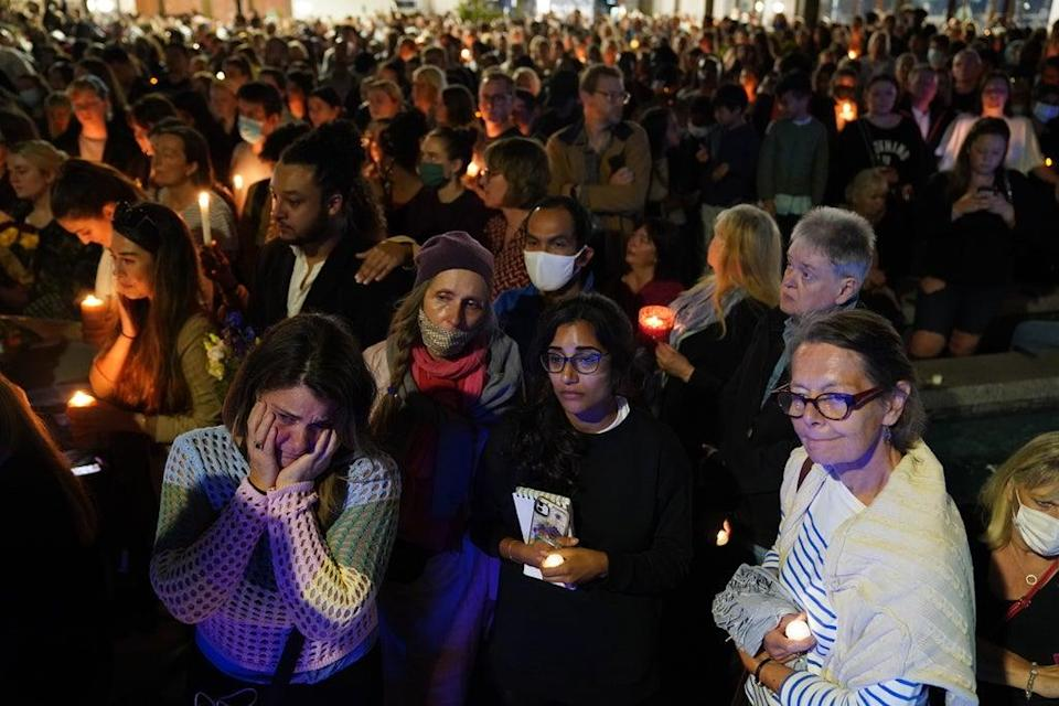 Members of the public attend a vigil in memory of Sabina Nessa (PA)