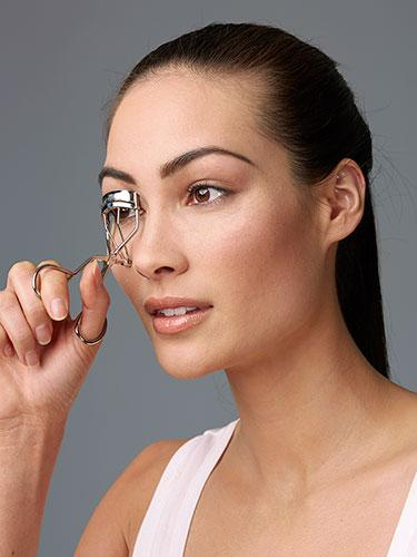 """<div class=""""caption-credit""""> Photo by: Brian Doben</div><div class=""""caption-title"""">Step 1</div>Start by curling the top lashes--I know it's scary, but don't do it and you may as well not wear mascara at all! Squeeze once at the base and hold for a few seconds. <br> <br> <b>More from REDBOOK: <br></b> <ul>  <li>  <a rel=""""nofollow"""" target="""""""" href=""""http://www.redbookmag.com/beauty-fashion/tips-advice/date-hair?link=rel&dom=yah_life&src=syn&con=blog_redbook&mag=rbk""""><b>50 Knockout Date-Night Hairstyles</b></a>  </li>  <li>  <a rel=""""nofollow"""" target="""""""" href=""""http://www.redbookmag.com/love-sex/advice/dates-america?link=rel&dom=yah_life&src=syn&con=blog_redbook&mag=rbk""""><b>The 50 Best Dates in the 50 States  <br></b></a>  </li> </ul>"""