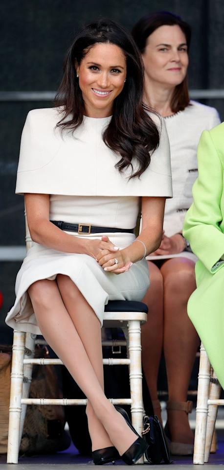 """<p>Meghan looked quite ladylike for her first solo appearance with the Queen. For the royal visit to Cheshire, she wore a Givenchy dress, and paired it with a black belt, shoes, and clutch. </p><p><a class=""""body-btn-link"""" href=""""https://www.sarahflint.com/collections/royal-treatment/products/perfect-pump-85-black-nappa?variant=7667623591966"""" target=""""_blank"""">Shop Similar</a> <em>Sarah Flint Perfect Pump 85, $355</em><br></p>"""
