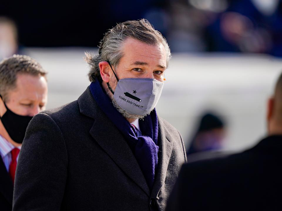 "<p>Ted Cruz (C) (R-TX), wearing a face mask that reads ""Come and Take It"", arrives to the inauguration of Joe Biden on the West Front of the US Capitol on 20 January 2021 in Washington, DC</p> ((Getty Images))"