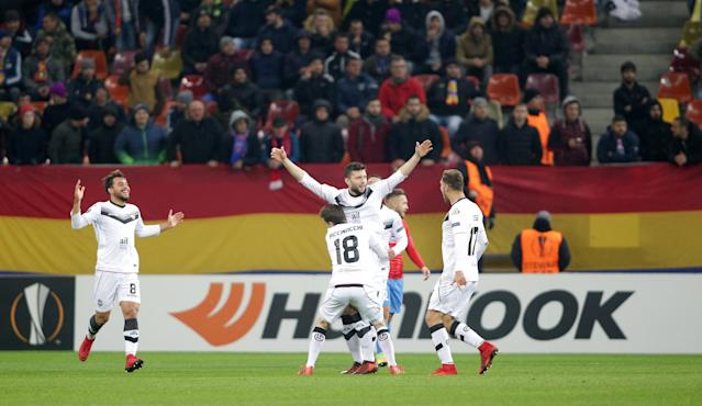 Soccer Football - Europa League - Steaua Bucharest vs FC Lugano - National Arena, Bucharest, Romania - December 7, 2017 Lugano's Fabio Daprela celebrates scoring their first goal with team mates REUTERS/Octav Ganea