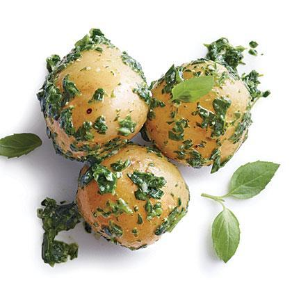 """<p>Dress up humble baby potatoes with a <a href=""""https://www.myrecipes.com/sauce-recipes/creative-pesto-recipes"""" rel=""""nofollow noopener"""" target=""""_blank"""" data-ylk=""""slk:homemade pesto"""" class=""""link rapid-noclick-resp"""">homemade pesto</a> that's both delicious and easy to prepare. </p>"""