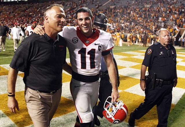Georgia head coach Mark Richt walks off the field with quarterback Aaron Murray (11) after defeating Tennessee 34-31 in overtime of an NCAA college football game on Saturday, Oct. 5, 2013, in Knoxville, Tenn. (AP Photo/Wade Payne)