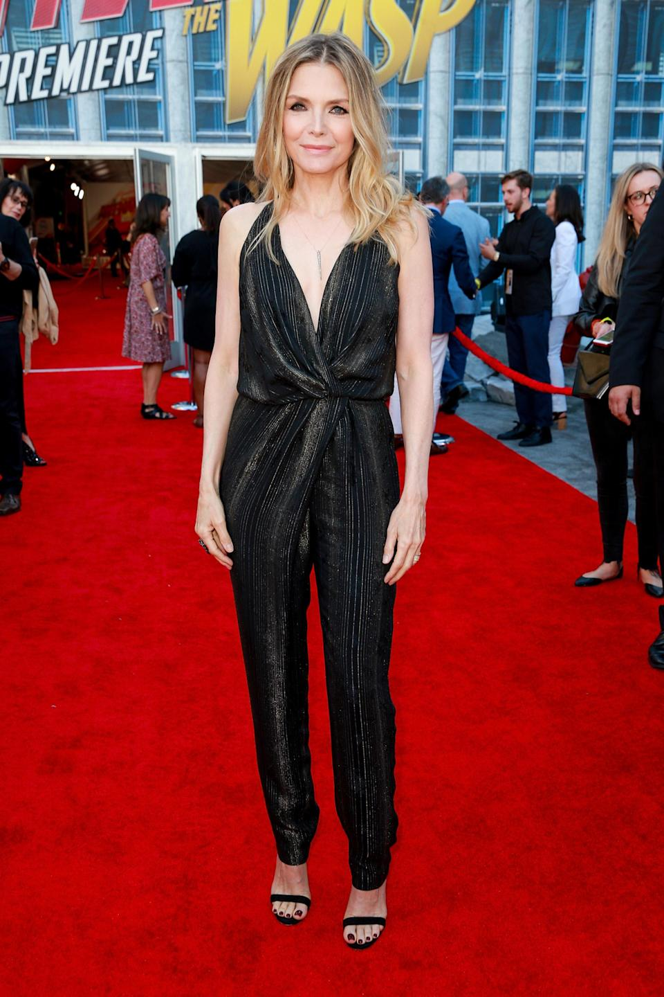 <p>On June 25, Michelle Pfeiffer joined the A-list crowd at the premiere of 'Ant-Man and the Wasp'. For the red carpet event, the actress chose a glitzy jumpsuit by Saint Laurent. <em>[Photo: Getty]</em> </p>