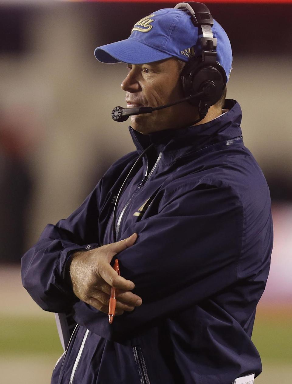 UCLA head coach Jim Mora looks on in the second quarter during an NCAA college football game against Utah Thursday, Oct. 3, 2013, in Salt Lake City. (AP Photo/Rick Bowmer)
