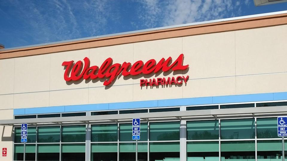 Sacramento, California, USA - September 21, 2016: View at the Walgreens Pharmacy store front and reserved hendicap parking.
