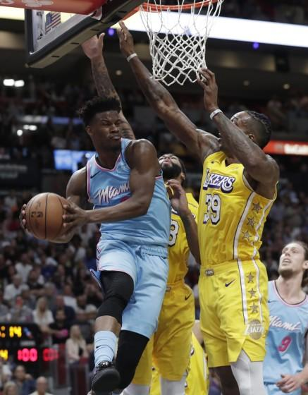 Miami's Jimmy Butler looks to pass after driving against Lakers defenders Dwight Howard (39) and Anthony Davis.
