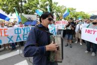 A man plays the accordion during a rally in support of former regional governor Sergei Furgal in Khabarovsk
