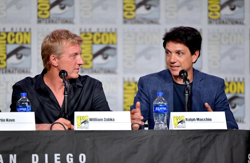 "SAN DIEGO, CALIFORNIA - JULY 18: William Zabka and Ralph Macchio speak at the ""Cobra Kai: Past, Present, And Future"" panel during 2019 Comic-Con International at San Diego Convention Center on July 18, 2019 in San Diego, California. (Photo by Amy Sussman/Getty Images)"