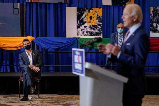 PHOTO: Puerto Rican singer Ricky Martin looks on as Democratic presidential nominee and former Vice President Joe Biden speaks at a Hispanic heritage event at Osceola Heritage Park on Sept. 15, 2020, in Kissimmee, Fla. (Drew Angerer/Getty Images)