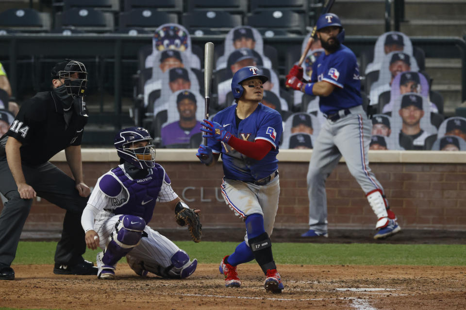 FILE - This Aug. 15, 2020, file photo shows Texas Rangers left fielder Shin-Soo Choo at bat in the fifth inning of a baseball game against the Colorado Rockies in Denver. Free agent Choo has agreed to a one-year contract to play for a baseball club in his native South Korea. Choo, who spent the last seven seasons with the Texas Rangers, signed a 2.7 billion won ($2.4 million) deal with a Korean Baseball Organization team owned by an affiliate with the Shinsegae business group, the company said in a statement Thursday, Feb. 25, 2021. (AP Photo/David Zalubowski, File)