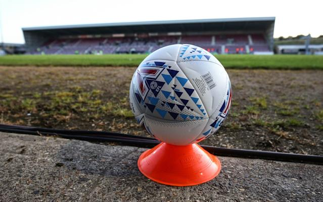 A general view of PTS Academy Stadium and a Mitre football placed on a plinth - GETTY IMAGES