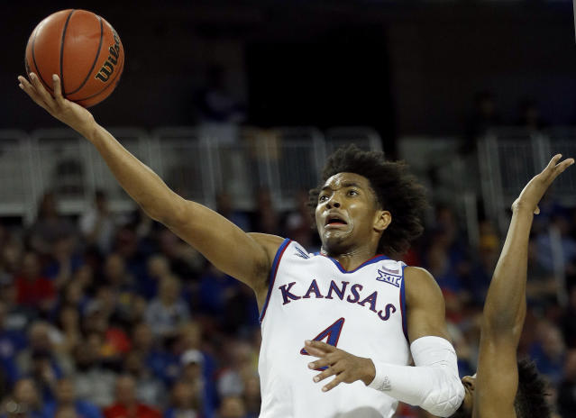 Kansas guard Devonte' Graham puts up a shot during the second half of an NCAA college basketball tournament first-round game against Pennsylvania Thursday, March 15, 2018, in Wichita, Kan. Kansas won 76-60. (AP Photo/Charlie Riedel)