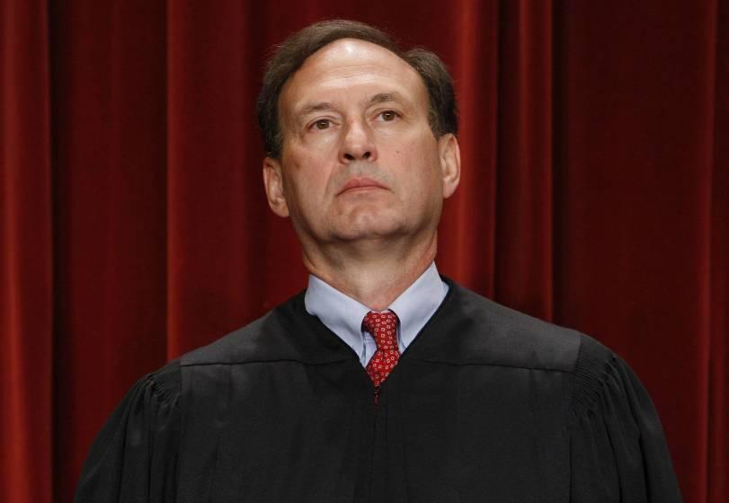 Associate Justice Samuel Alito Jr. sits for a new group photograph at the Supreme Court in Washington.