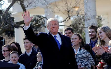 U.S. President Donald Trump waves after addressing the annual March for Life rally, taking place on the National Mall, from the White House Rose Garden in Washington