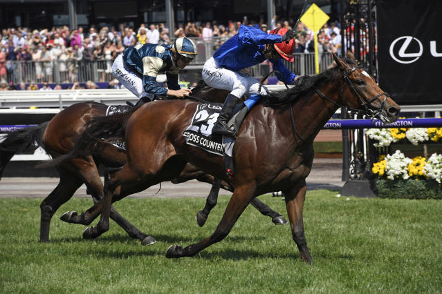 Cross Counter with jockey Kerrin McEvoy on board, right wins the Melbourne Cup ahead of second placed Marmelo, left at Flemington Racecourse in Melbourne, Australia, Tuesday, Nov. 6, 2018. (AP Photo/Andy Brownbill)