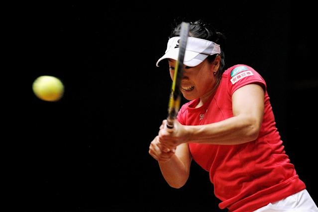 'S-HERTOGENBOSCH, NETHERLANDS - APRIL 19: Kurumi Nara of Japan in action against Arantxa Rus of Netherlands during the Fed Cup World Group II Play-off match between Netherlands and Japan at the Maaspoort Sports end Events on April 19, 2014 in 's-Hertogenbosch, Netherlands. (Photo by Dean Mouhtaropoulos/Getty Images)