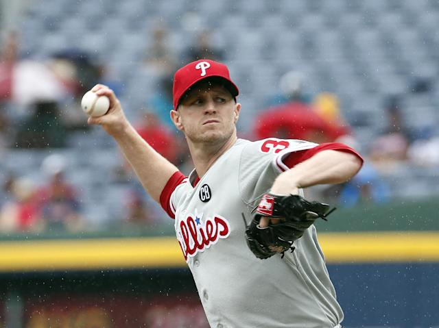 Philadelphia Phillies starting pitcher Kyle Kendrick works in the first inning of a baseball game against the Atlanta Braves in Atlanta, Sunday, July 20, 2014.(AP Photo/John Bazemore)