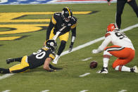 Pittsburgh Steelers quarterback Ben Roethlisberger (7), James Conner (30), and Cleveland Browns defensive end Myles Garrett (95) attempt to recover a fumbled high snap during the first half of an NFL wild-card playoff football game, Sunday, Jan. 10, 2021, in Pittsburgh. Cleveland Browns strong safety Karl Joseph (42) recovered the ball in the end zone for a touchdown. (AP Photo/Keith Srakocic)