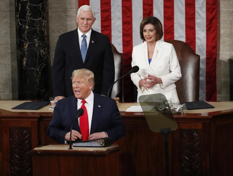 US President Donald J. Trump (B) reacts in front of Speaker of the House Nancy Pelosi (R) and Vice President Mike Pence (L) as he arrives to deliver his State of the Union address during a joint session of congress in the House chamber of the US Capitol in Washington, DC, USA. EFE/EPA/SHAWN THEW