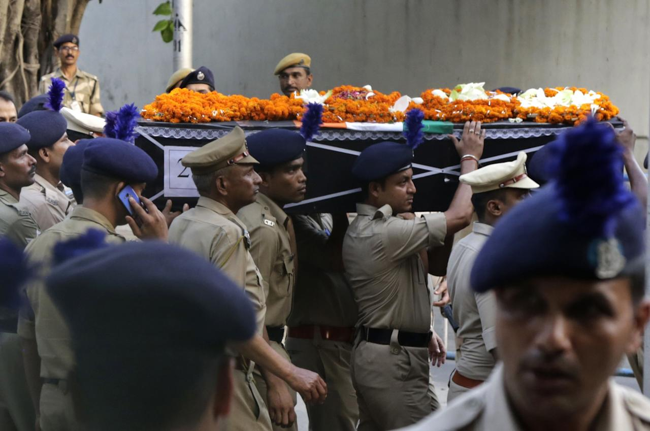 <p>India's Central Reserve Police Force personnel carry a coffin containing the body of their colleague Sanjay Kumar towards his home in Palampur, about 40 kilometers (25 miles) south of Dharmsala, India, Tuesday, April 25, 2017. Kumar was among 25 Indian paramilitary soldiers who were killed by Maoist rebels in central India on Monday in one of the worst attacks on the country's security forces in recent years. (AP Photo/Ashwini Bhatia) </p>