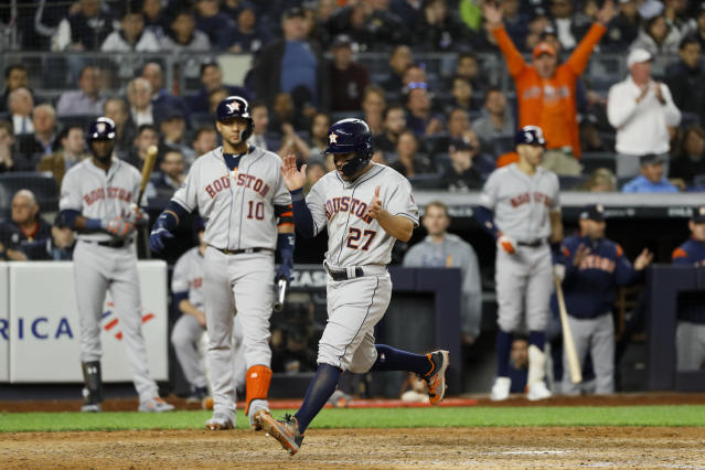 Houston Astros' Jose Altuve celebrates after scoring on a wild pitch during the seventh inning in Game 3 of baseball's American League Championship Series against the New York Yankees Tuesday, Oct. 15, 2019, in New York. (AP Photo/Matt Slocum)