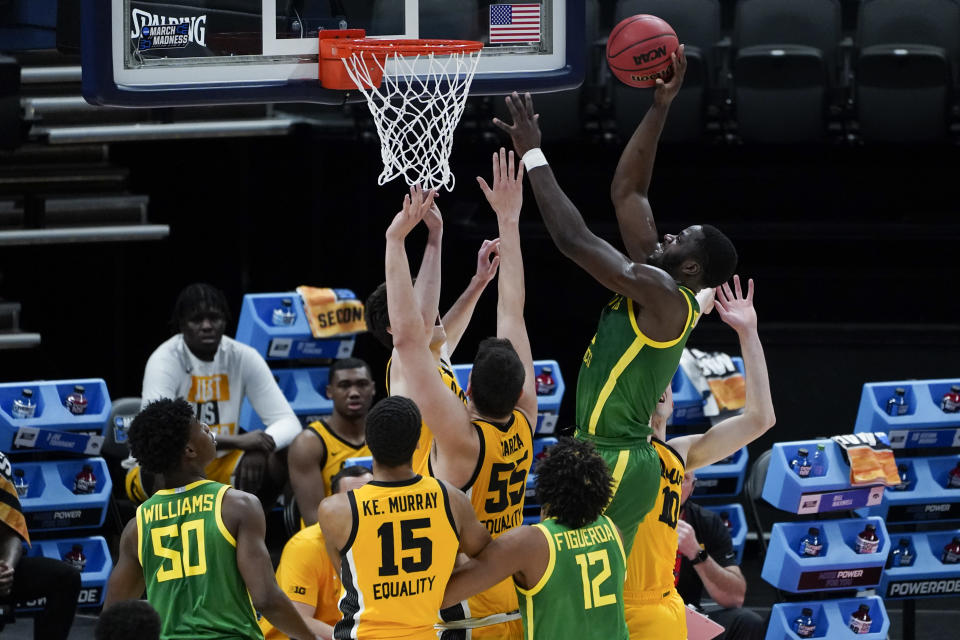 Oregon forward Eugene Omoruyi (2) shoots against Iowa during the first half of a men's college basketball game in the second round of the NCAA tournament at Bankers Life Fieldhouse in Indianapolis, Monday, March 22, 2021. (AP Photo/Paul Sancya)