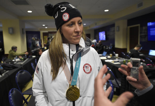 FILE - In this Saturday, March 3, 2018, file photo, Meghan Duggan, of the gold medal winning U.S. women's Olympic hockey team, listens to a question from the media before an outdoor NHL hockey game between the Washington Capitals and the Toronto Maple Leafs, in Annapolis, Md. The leading female hockey players in Sweden were refusing to attend a training camp Thursday, Aug. 15, 2019, or play in an upcoming international tournament in Finland over a pay dispute with the countrys federation. Among those coming out in support of the Swedish players was Duggan.(AP Photo/Nick Wass, File)