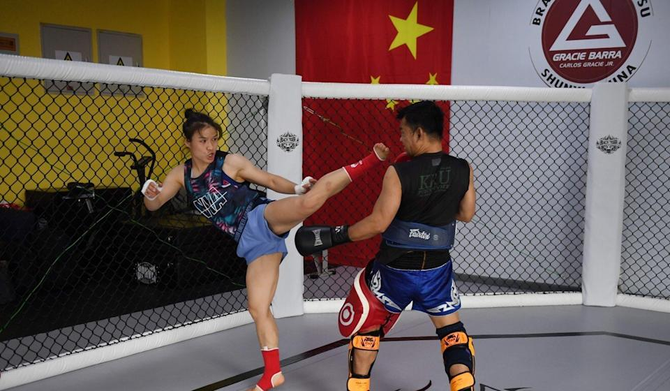 MMA champion Zhang Weili (left) trains at a gym in Beijing. Photo: AFP