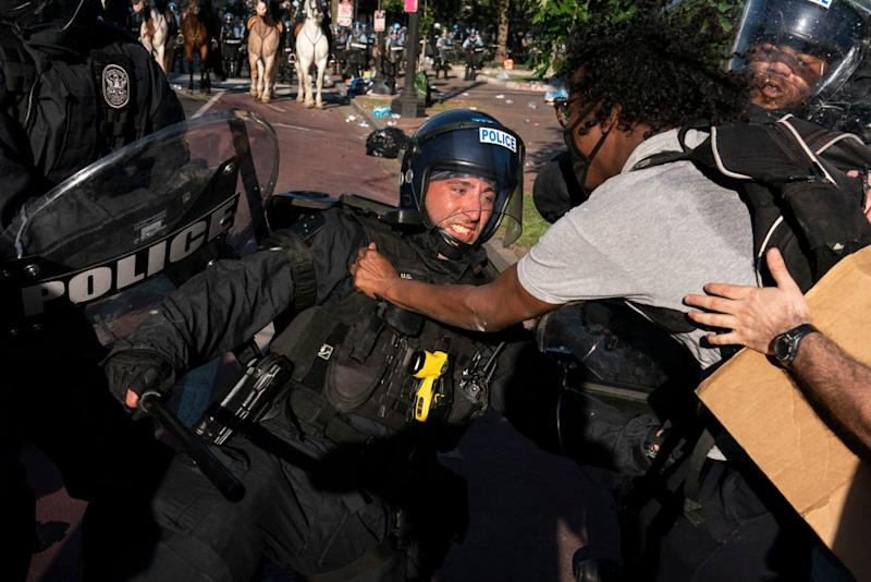 A protester clashes with police in Washington prior to Mr Trump's announcement. Source: Getty
