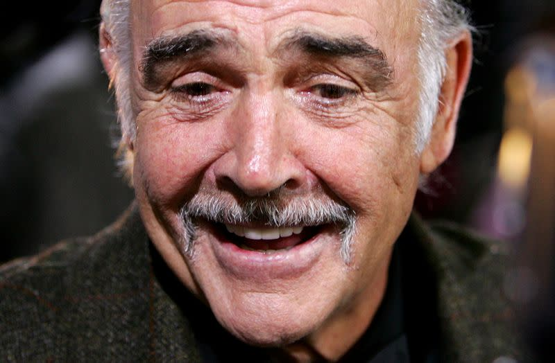 FILE PHOTO: British actor Connery smiles as he arrives on the red carpet for the European film award ceremony in Berlin
