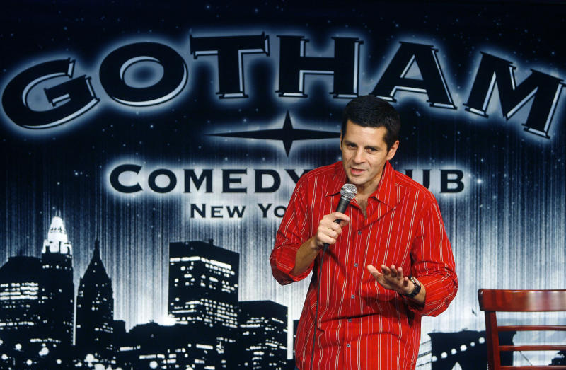 In a Nov. 15, 2006 file photo, Festival co-founder Dean Obeidallah performs at the Fourth Annual New York Arab-American Comedy Festival at the Gotham Comedy Club in New York. Arab-Muslim stand-up comedy is flourishing more than a decade after the terrorist attacks of Sept. 11. (AP Photo/Gary He)