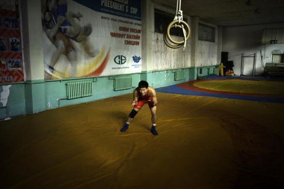 Mongolia's Olympic freestyle 60kg wrestler Mandakhnaran Ganzorig limbers up at a wrestling gym in Ulan Bator, October 27, 2011.